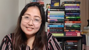 A photo of the blogger Yna the Mood Reader on her shelf.